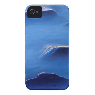 Sunset on rocks protruding through foamy water iPhone 4 case
