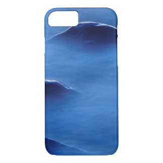 Sunset on rocks protruding through foamy water iPhone 7 case