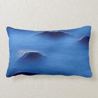 Sunset on rocks protruding through foamy water lumbar pillow