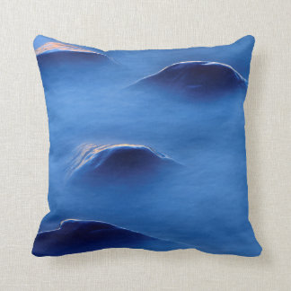 Sunset on rocks protruding through foamy water throw pillow