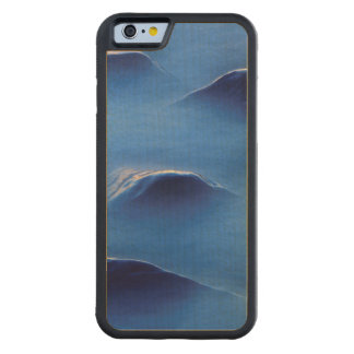 Sunset on rocks protruding through foamy water carved® maple iPhone 6 bumper
