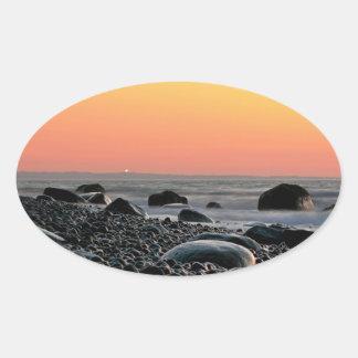Sunset on the Baltic Sea coast Oval Sticker