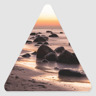 Sunset on the Baltic Sea coast Triangle Sticker