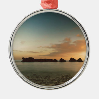 Sunset on the beach metal ornament