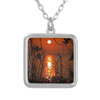 Sunset on the ocean with trees pendants