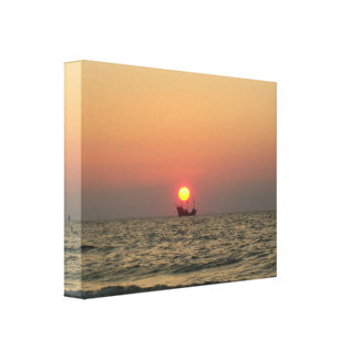 Sunset on the sea with pirate boat canvas print