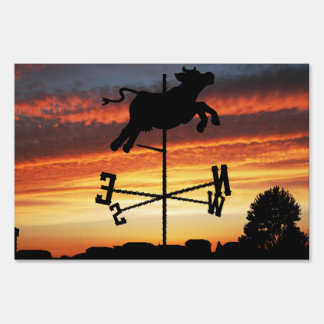 Sunset Over a Cow Weather Vane Sign