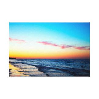 Sunset over beach canvas print