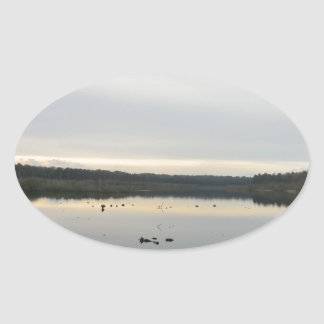 Sunset over Blakemere Moss in Winter Oval Sticker