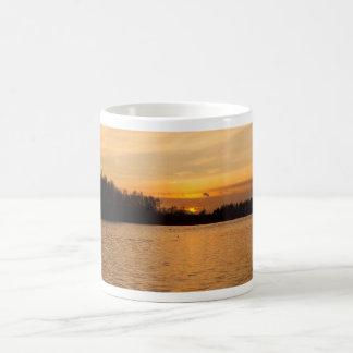Sunset over lake coffee mug