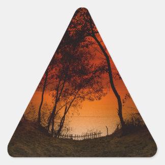 Sunset over Lake Michigan dunes Triangle Sticker
