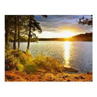 Sunset over lake postcard