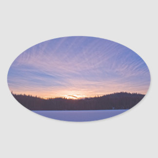 Sunset over Snow-covered Winter Lake & Trees Oval Sticker