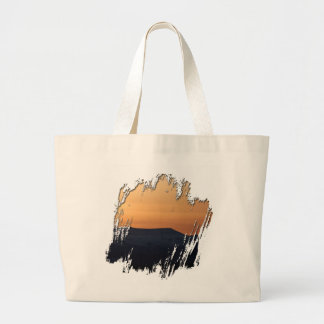 Sunset Over Snowy Mountains Bags