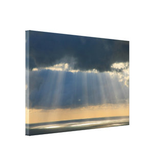 Sunset over the ocean stretched canvas print