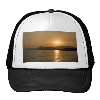 Sunset over the sea trucker hat