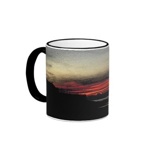 Sunset over the sea in Aberystwyth mug