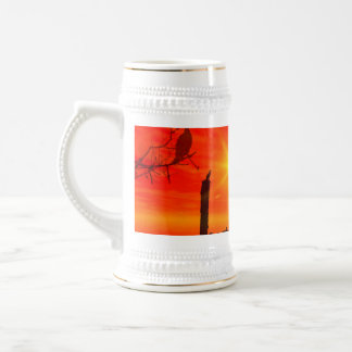 Sunset over the sea with birds beer stein