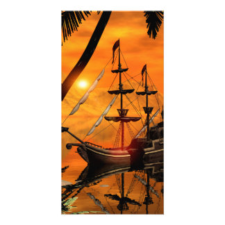 Sunset over the sea with ship photo card