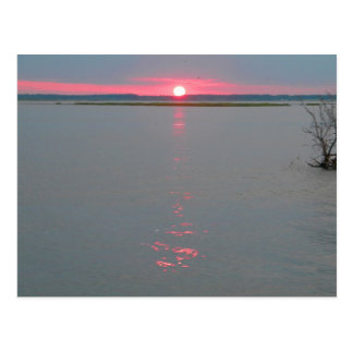 Sunset over the water postcard