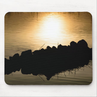 Sunset reflected in calm water and back lit rocks mouse pad