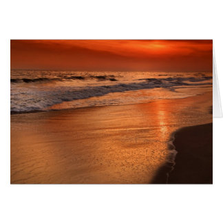 Sunset reflections off clouds and ocean shore greeting card
