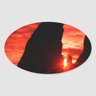 Sunset Sea Stacks Blood Red Oval Sticker
