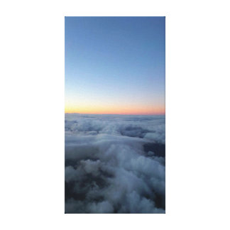 Sunset sky view from above the clouds, flying high canvas print