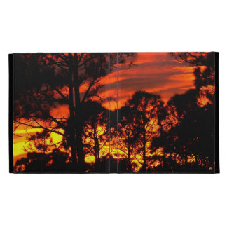 Sunset through pines red yellow iPad folio cover