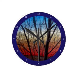 Sunset thru' trees round wallclock