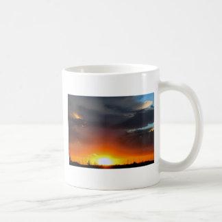 Sunset under the storm. coffee mug
