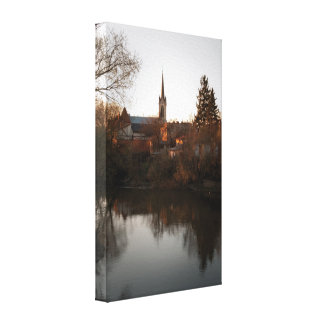 Sunset view of river and cathedral canvas print