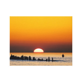 Sunset with angler on shore of the Baltic Sea Stretched Canvas Prints