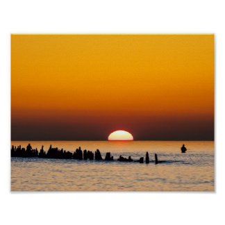 Sunset with angler on shore of the Baltic Sea Poster
