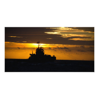 sunset with boat over the sea photo card