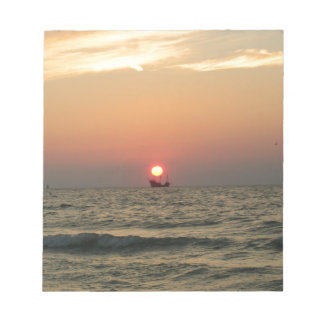 Sunset with pirate boat notepad