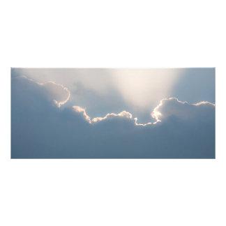 Sunshine behind clouds full color rack card