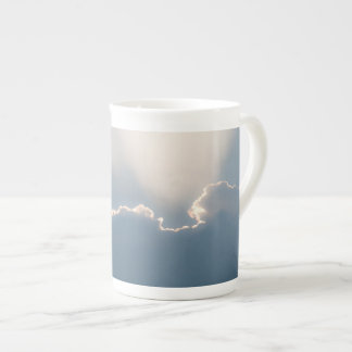 Sunshine behind clouds tea cup