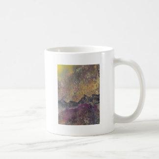 Sunshine over craggy landscape coffee mug