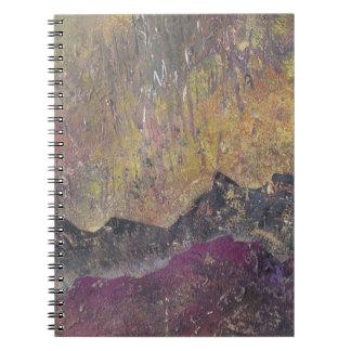 Sunshine over craggy landscape notebook