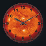 """Super Prominence - Sun in Space Large Clock<br><div class=""""desc"""">A superprominence of our sun in space. Mysterious photo, our sun turned blue. Please feel free to fully customize this product to your needs. Change from landscape to portrait (or from horizontal to vertical layout) or the other way around, zoom in or zoom out and add your own text (add...</div>"""