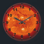 "Super Prominence - Sun in Space Large Clock<br><div class=""desc"">A superprominence of our sun in space. Mysterious photo, our sun turned blue. Please feel free to fully customize this product to your needs. Change from landscape to portrait (or from horizontal to vertical layout) or the other way around, zoom in or zoom out and add your own text (add...</div>"