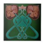 """Superb Art Nouveau Floral Antique Reproduction Ceramic Tile<br><div class=""""desc"""">Reproduced from a striking original antique tile in dark green, teal, aqua, pink. rose, and cranberry Art Nouveau floral tile that is more than 100 years old. Art Nouveau tiles are highly collectible and make great wall tiles, backsplashes for kitchen, bath and laundry room, fireplace surrounds, trivets, coasters, decorative accessories,...</div>"""