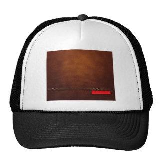 Superficie de cuero de Brown con la etiqueta roja Gorras De Camionero