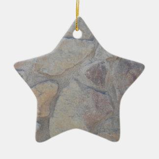 Superficie de la roca adorno navideño de cerámica en forma de estrella