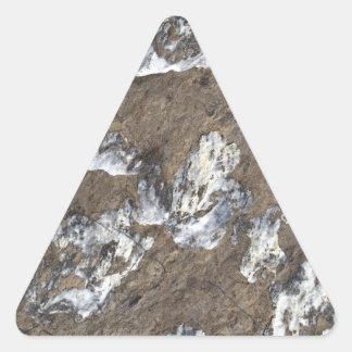 Superficie de la roca pegatina triangular