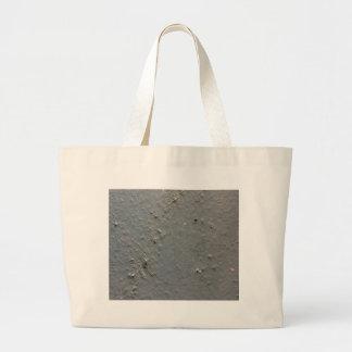 Superficie rugosa texturizada gris con efecto del bolsa de mano