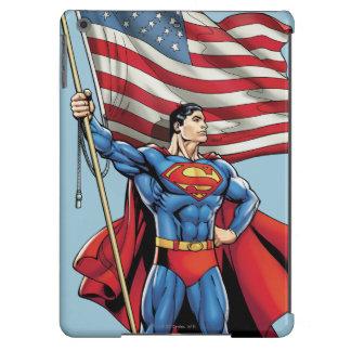 Superhombre que sostiene la bandera de los carcasa iPad air