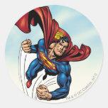 Superhombre rápido a través del aire pegatina redonda