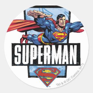 Superhombre y logotipo confinados pegatina redonda